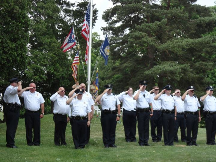 Men Saluting the Flag
